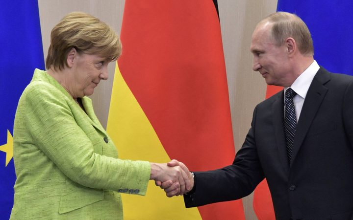 Russian President Vladimir Putin and the Federal Chancellor of Germany Angela Merkel during a joint press conference on the outcome of their meeting.