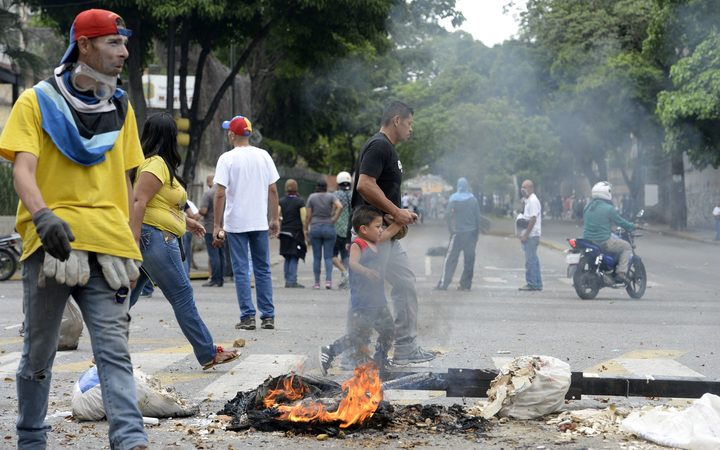 Demonstrators block a street in Caracas during a protest against Venezuelan President Nicolas Maduro.