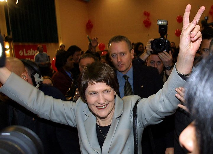 New Zealand Prime Minister Helen Clark  flashes the victory sign as she makes her way onstage after winning the 2002 eleciton.