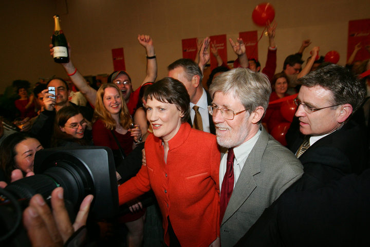 Leader of the Labour Party, and PM, Helen Clark (C), accompanied by her husband Peter Davis (R) arrives at Labour party election headquarters, 17 September 2005.