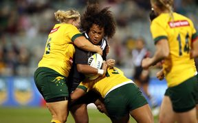 Kiwi Fern Teuila Fotu-Moala tackled by the Australian Jillaroos during their ANZAC Test in Canberra.