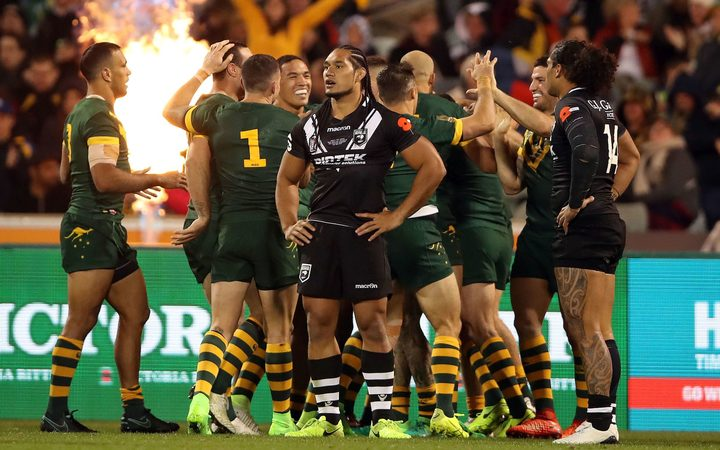 Martin Taupau looks dejected after yet another Kangaroos try.