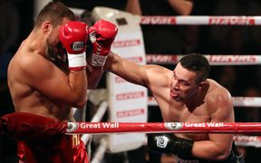 Joseph Parker lands a punch during his fight with Razvan Cojanu for the WBO World Heavyweight title.