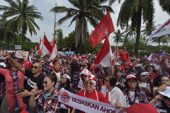 Supporters of Jakarta governor Basuki Tjahaja Purnama, also known as Ahok, dance outside the North Jakarta court.