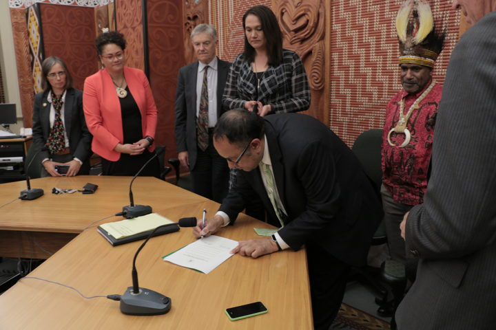 New Zealand MPs sign the International Parliamentarians for West Papua declaration as Benny Wenda the head of the West Papua Freedom Movement looks on. Wellington 10-05-2017.