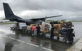 A French military plane is loaded with supplies bound for the cyclone-hit New Caledonia island of Lifou.