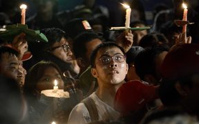 Protesters hold up lighted candles during a gathering outside the Indonesian High Court building in Jakarta to demand the release of Basuki Tjahaja Purnama.