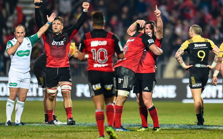 Crusaders players celebrate as full-time is called in the 20-12 win over the Hurricanes.