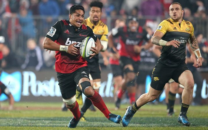 Pete Samu on the burst for the Cruasaders with the Hurricanes skipper TJ Perenara in pursuit.