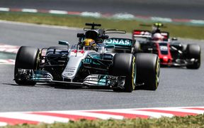 Lewis Hamilton powered to a dramatic win in Spain.