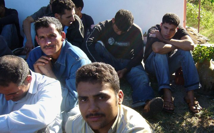 A group of illegal refugees are pictured after their arrival at Catanzaro lido, 01 October 2007.