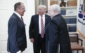 This file handout photo taken on May 10, 2017 made available by the Russian Foreign Ministry shows shows US President Donald Trump (C) speaking with Russian Foreign Minister Sergei Lavrov (L) and Russian Ambassador to the US, Sergei Kislyak during a meeting at the White House in Washington, DC.