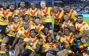 The PNG Kumuls celebrate beating the Cook Islands.