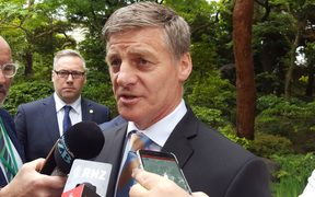 NZ Prime Minister Bill English speaks to reporters in Japan.