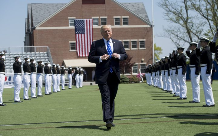 US President Donald Trump arrives at the US Coast Guard Academy Commencement Ceremony in New London, Connecticut.