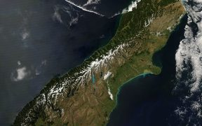 The Alpine Fault is marked out on satellite images by the western edge of the Southern Alps snowline.