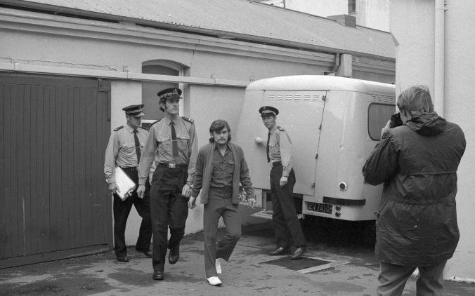 Dean Wickliffe is led away by police after being convicted of murder in May 1972
