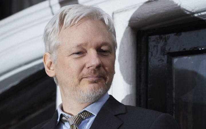 Defiant Assange says will not 'forgive and forget'