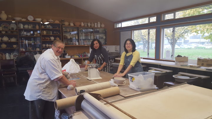 Class tutor Shona Clarkson works with May Li and Catherine Khor at the Mt Pleasant Pottery Group session.