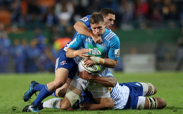 Blues player Piers Francis tackle by Shaun Treeby of the Stormers in their Super Rugby game.