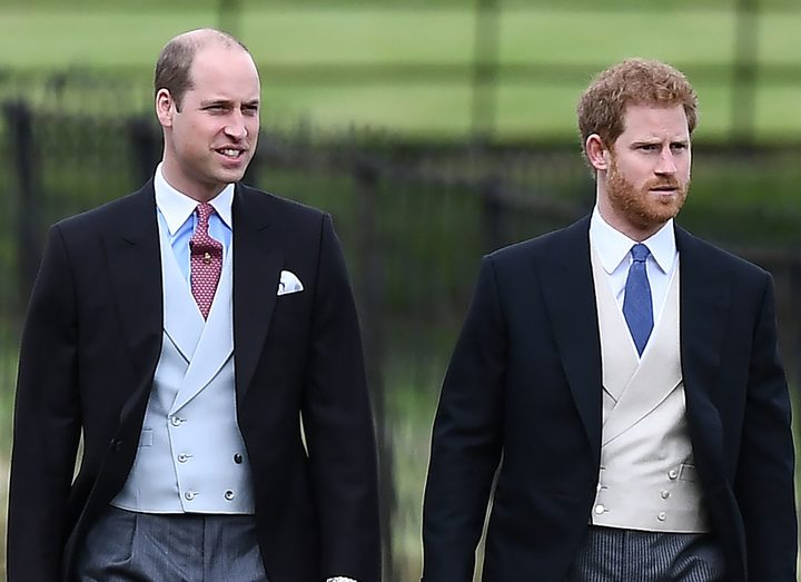 Britain's Prince Harry (R) and Britain's Prince William, Duke of Cambridge walk to the church