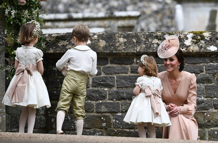 Britain's Catherine, Duchess of Cambridge (R) stands with her daughter Britain's princess Charlotte,