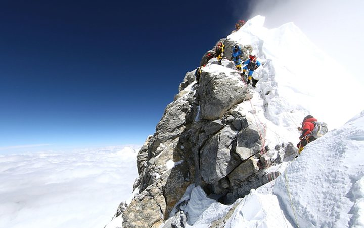 Unidentified mountaineers walk past the Hillary Step while pushing for the summit of Everest on May 20, 2011.