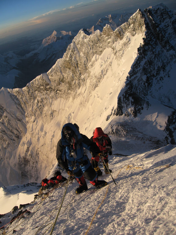 Unidentified mountaineers walk past the Hillary Step 29 May 2013.