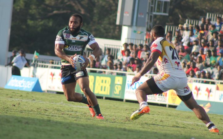 Sebastian Pandia looks to test the PNG Hunters defence.