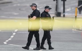 Armed police patrol outside the scene of the Manchester explosion.