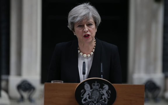 Britain's Prime Minister Theresa May delivers a statement outside 10 Downing Street