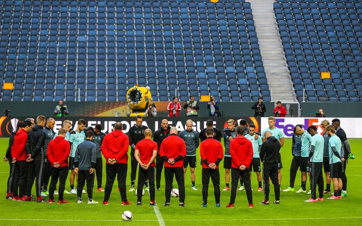 Ajax footballers stand in silence for the victims of the Manchester Arena explosion in training ahead of the UEFA Europa League final against Manchester United at Friends Arena in Solna outside Stockholm, Sweden.