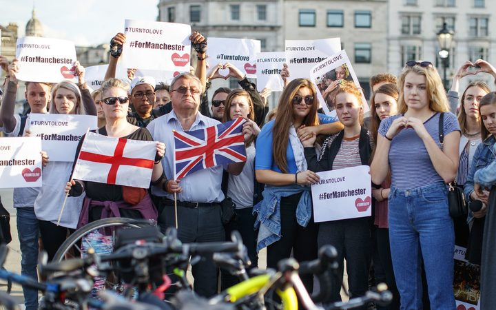 People gather in Trafalgar Square in London to pay tribute to the victims of the attack.