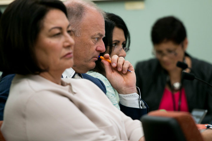 National MPs Hekia Parata (left), Jono Naylor (right), and Parmjeet Parmar listen to the Ministry for Vulnerable Children, Oranga Tamariki give evidence to the Justice and Electoral Committee.