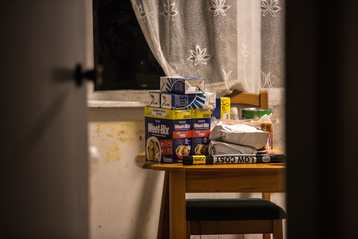 Fresh groceries sit on the kitchen table of a low income family's home.