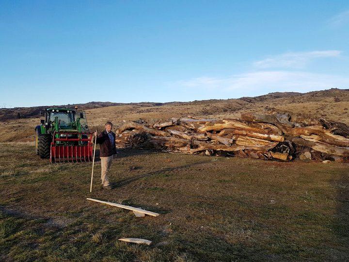 Ken Gillespie prepares the bonfire for the Brass Monkey Rally in Central Otago