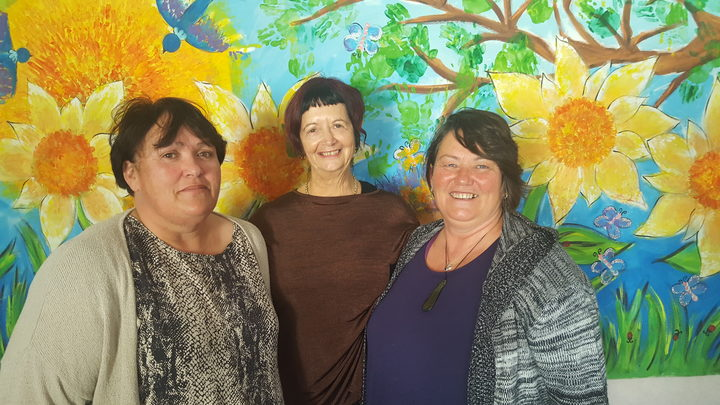 Family Works Whangarei social workers: Louise Walker, Margie Matthews and Michelle Arkin. Mural by their young clients.