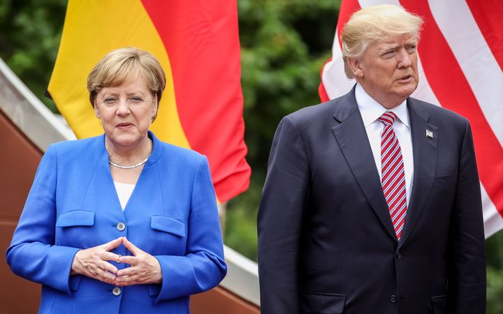 German Chancellor Angela Merkel and US President Donald Trump at the G7 summit in Sicily on 26 May.