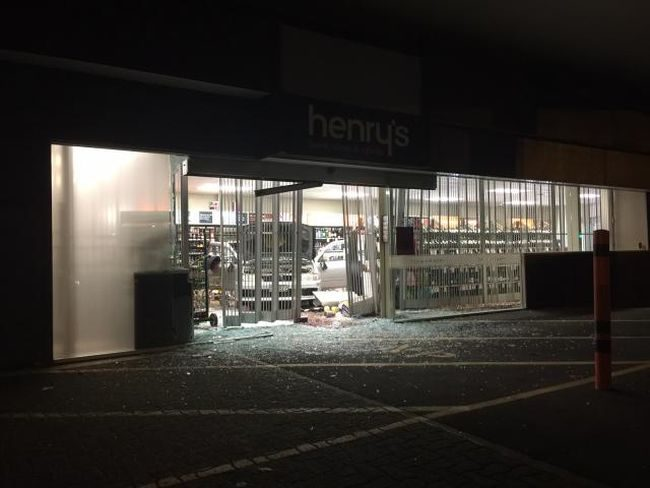 Smashed glass doors at Henry's Liquor store,Yaldhurst Road, Christchurch.