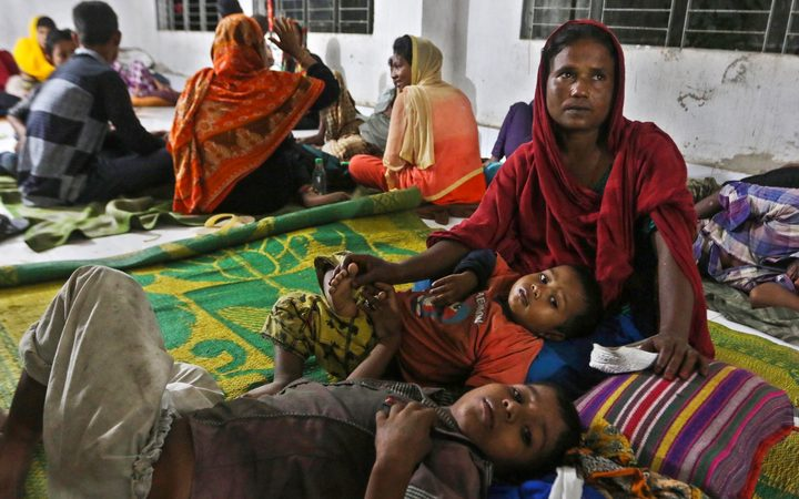 Bangladeshi villagers take refuge in a cyclone shelter in Cox's Bazar district.