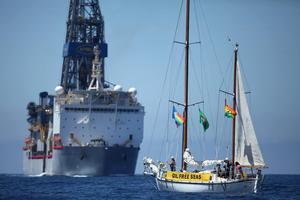 Anadarko's drill ship and a protest boat at the site on Tuesday.
