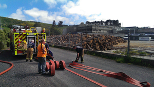 Fire crews pack up at the site.