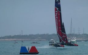 Emirates Team New Zealand crosses the finish line 29 seconds after Oracle Team USA in their final race of the America's Cup qualifiers.