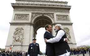 Indian Prime Minister Narendra Modi says goodbye to French President Emmanuel Macron after a ceremony at the Arc de Triomphe on the last leg of his four-nation visit in Paris.