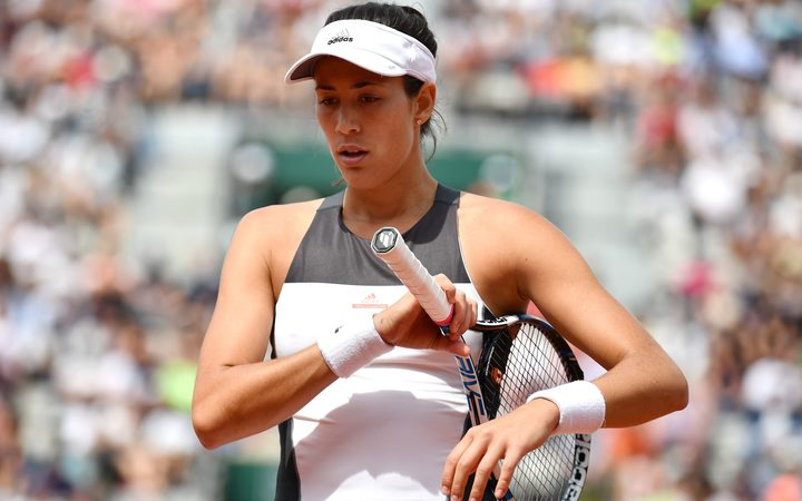 Garbine Muguruza of Spain reacts during the match against Kristina Mladenovic of France in their 4th round match of the French Open tennis tournament at the Roland Garros. June 04, 2017.