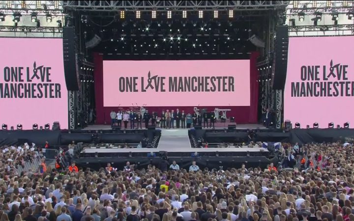 Those gathered at the One Love Manchester benefit concert have a minute's silence before the concert begins.