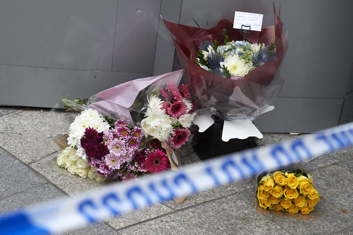 Flowers by the police cordon outside The Shard in London as a tribute to victims.