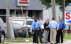 Investigators work the scene of a multiple shooting at an area business in an industrial area on June 5, 2017 northeast of downtown Orlando, Florida.