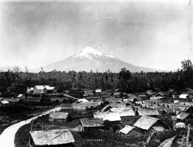 Parihaka Pa, circa 1900, with Mount Taranaki - taken by an unidentified photographer.