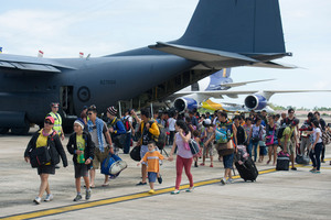 Typhoon Haiyan survivors evacuated by the RNZAF disembark in Cebu.